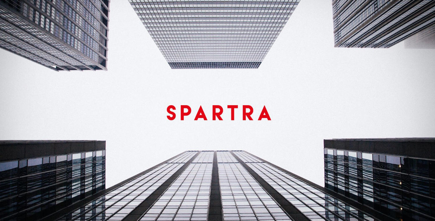 Spartra red logo between two sky scapers